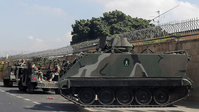 Lebanese army soldiers secure the area around the French ambassador's residence in Beirut on Wednesday. France has ordered special security measures around its embassies and schools because of fears of a hostile reaction to a magazine's publication of cartoons of the Prophet Mohammed, the foreign ministry said.