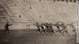 Harvard ROTC cadets are doing a bayonet drill in the school's stadium in 1917-1918.
