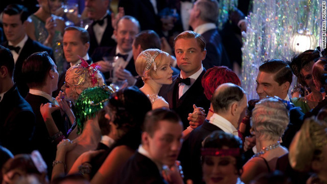 Carey Mulligan stars as Daisy Buchanan and Leonardo DiCaprio stars as Jay Gatsby in