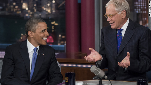 Obama and David Letterman speak during a break in the taping of the &quot;Late Show with David Letterman&quot; at the Ed Sullivan Theater on Tuesday in New York.