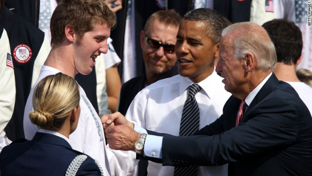 Olympic swimming silver medalist Jimmy Feigen, left, is greeted by Obama and Vice President Joe Biden on the South Lawn to welcome the 2012 U.S. Olympic and Paralympic teams on Friday.
