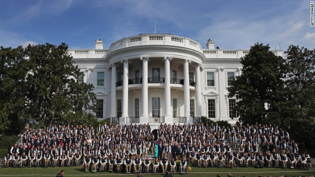 President Barack Obama, first lady Michelle Obama and Vice President Joe Biden pose for a photograph with members of the U.S. Olympic and Paralympic teams at the White House on Friday in Washington. The U.S. team brought home 104 medals, 46 of them gold, from the Games in London.