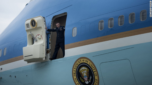 A crew member opens the door to Air Force One after the jet arrived at John F. Kennedy Airport in New York on Tuesday.