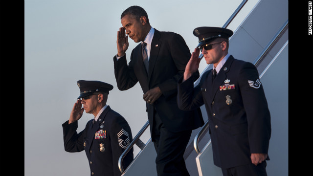 President Barack Obama arrives at Andrews Air Force Base in Maryland on Thursday, September 13. Obama returned to Washington after a two-day campaign trip with events in Nevada and Colorado. <a href='http://www.cnn.com/SPECIALS/world/photography/index.html' target='_blank'>See more of CNN's best photography</a>.