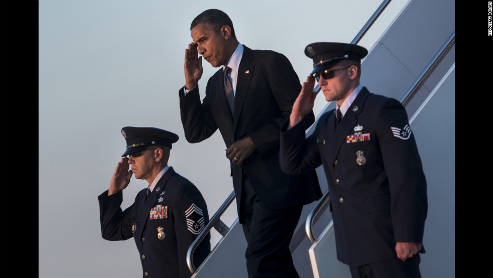 President Barack Obama arrives at Andrews Air Force Base in Maryland on Thursday, September 13. Obama returned to Washington after a two-day campaign trip with events in Nevada and Colorado. &lt;a href='http://www.cnn.com/SPECIALS/world/photography/index.html' target='_blank'&gt;See more of CNN's best photography&lt;/a&gt;.