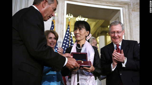 Burmese opposition politician Aung San Suu Kyi, center, is presented with a U.S. Congressional Gold Medal by Speaker of the House John Boehner, left, as House Minority Leader Nancy Pelosi, second left, and Senate Minority Leader Mitch McConnell, right, look on during a presentation ceremony at the Rotunda of the U.S. Capitol on Wednesday in Washington. Aung San Suu Kyi was presented with the medal for her leadership and commitment to human rights and for promoting freedom, peace and democracy in Myanmar, also known as Burma.