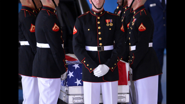 U.S. Marines stand around a casket during the transfer of remains ceremony marking the return to the United States of the remains of the four Americans killed in an attack this week in Benghazi, Libya, at Andrews Air Force Base in Maryland on Friday. U.S. Ambassador Christopher Stevens died along with three other Americans in the assault on the consular building in Benghazi on September 11.