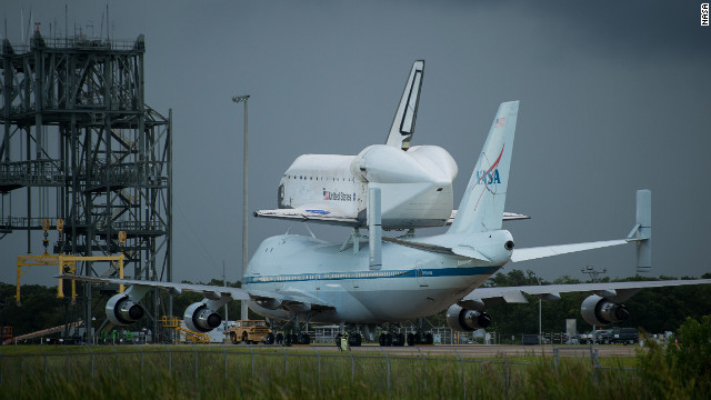 Space shuttle Endeavour is seen atop NASA's Shuttle Carrier Aircraft at the Shuttle Landing Facility at Kennedy Space Center on Monday, September 17, in Cape Canaveral, Florida. &lt;a href='http://www.cnn.com/SPECIALS/world/photography/index.html'&gt;See more of CNN's best photography&lt;/a&gt;.