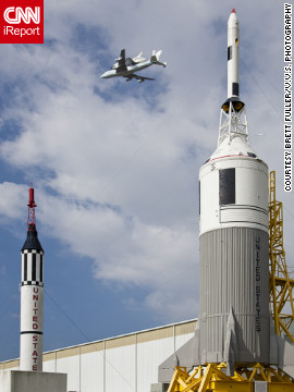Endeavour <a href='http://ireport.cnn.com/docs/DOC-843801'>flies over retired rockets</a> at Johnson Space Center in Texas.