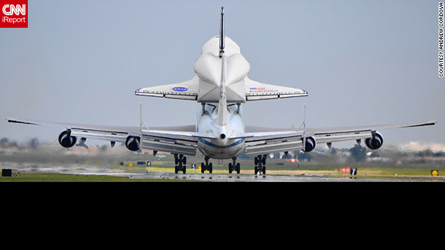 The carrier aircraft and Endeavour &lt;a href='http://ireport.cnn.com/docs/DOC-843920'&gt;touch down at Ellington Field&lt;/a&gt; in Houston on Wednesday, midway through their journey to Los Angeles.
