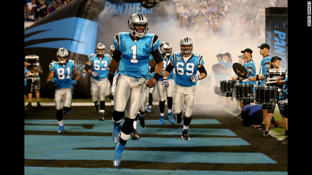 Quarterback Cam Newton of the Carolina Panthers leads his teammates onto the field to play against the New York Giants on Thursday. Look back at the best of Week 2 and at see more of CNN's best photography.