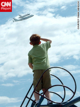 "Spencer Niegocki, 10, <a href='http://ireport.cnn.com/docs/DOC-844391'>salutes Endeavour</a> from the top of a playground slide as the shuttle is flown over Tucson, Arizona, on Thursday, September 20. ""Years from now, he will be able to look back and say he saw the last shuttle get carried to its final home,"" said his father, Dann Niegocki. ""He may not understand it now, but we all participated in something impressive through the shuttle program."""