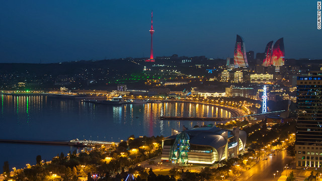 The Flame Towers of Baku, Azerbaijan, twist sensually high above the capital's skyline. They are completely covered in LED screens and at night flicker like fire, visible from all points in the city.
