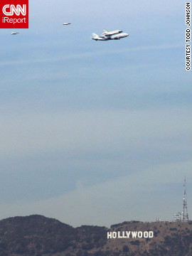Endeavour flies low &lt;a href='http://ireport.cnn.com/docs/DOC-844966'&gt;over the Hollywood sign&lt;/a&gt; as it travels toward its final destination in Los Angeles on Friday.