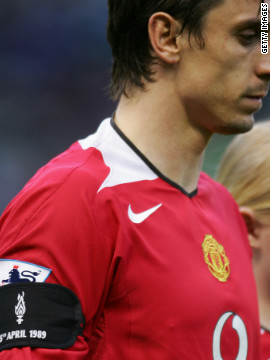 At times, the two sets have fans have used the two tragedies as a way of trying to provoke each other. On the pitch, this picture shows Manchester United captain Gary Neville wearing a black armband in honor of the Hillsborough victims during a match in 2004.