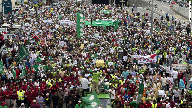Malaysian Muslim demonstrators march toward the U.S. Embassy after a Friday mass prayer in Kuala Lumpur.