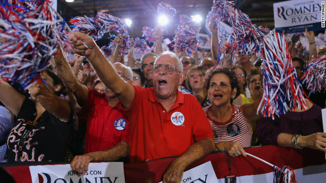 Supporters cheer as they listen to Romney speak during a Juntos Con Romney Rally at the Darwin Fuchs Pavilion on Wednesday in Miami. <a href='http://www.cnn.com/SPECIALS/world/photography/index.html'>See more of CNN's best photography</a>.