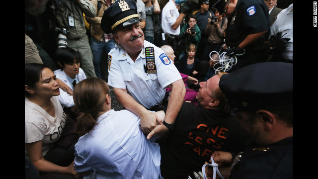 "NYPD arrests protesters affiliated with Occupy Wall Street as they attempt to form a ""Peoples Wall"" to block Wall Street on the one-year anniversary of Occupy on Monday in New York. "