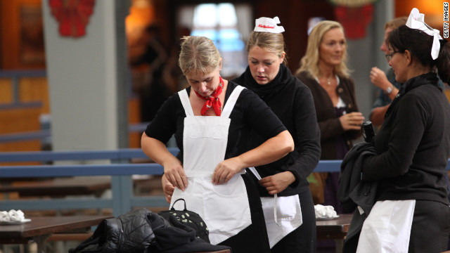 Waitresses prepare for the opening day of Oktoberfest 2012.