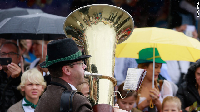 A tuba player performs as a parade kicks off the festival.
