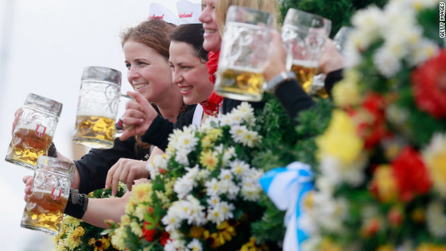 Waitresses of the Spaten brewery wave with beer mugs. See more of CNN's best photography.