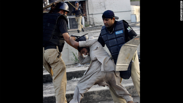 Pakistani police detain a demonstrator in Lahore on Friday during a protest against the film &quot;Innocence of Muslims.&quot;