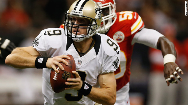 Brees scrambles to get away from the Chiefs' Jovan Belcher.
