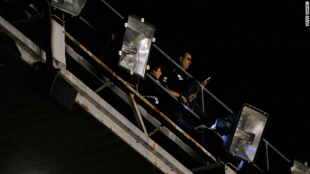 Engineers assess the damage after Real Madrid's game at Rayo Vallecano was called off on Sunday night.