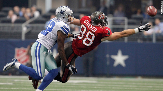 Barry Church of the Dallas Cowboys pressures Luke Stocker of the Tampa Bay Buccaneers.