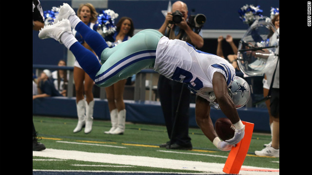 Dallas' DeMarco Murray vaults for a touchdown.