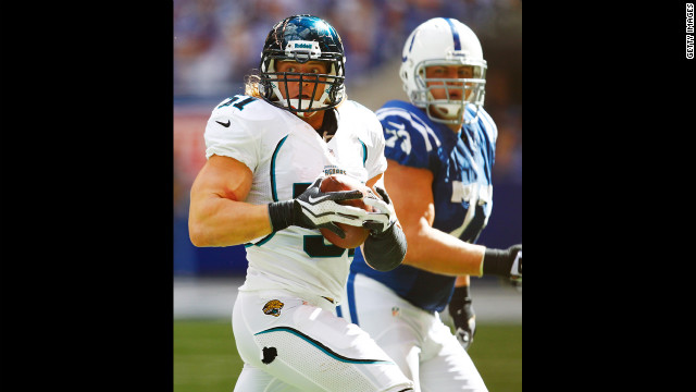 Paul Posluszny of the Jacksonville Jaguars looks for a teammate to lateral to after an interception against the Indianapolis Colts.