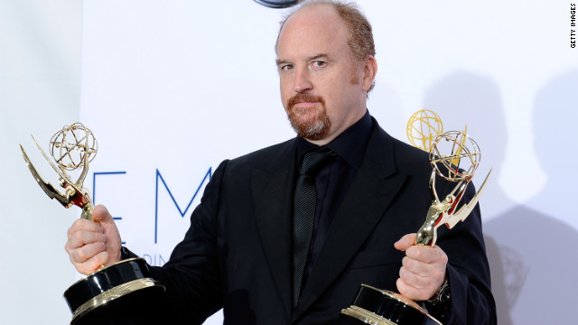  Louis C.K. holds his two trophies for oustanding comedy writing for &quot;Louie&quot; and outstanding writing on a variety, music or comedy special for &quot;Live at the Beacon Theatre.&quot; 