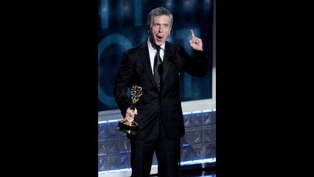 Tom Bergeron accepts the award for outstanding host of a reality or reality-competition program for &quot;Dancing With the Stars.&quot;