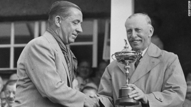 The great Walter Hagen is handed the trophy after a convincing victory for the Americans in the 1937 match at Southport -- the first time an away team had claimed the trophy. 