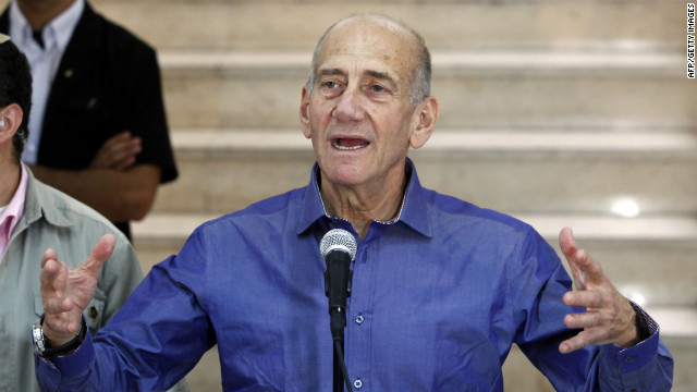 Ehud Olmert speaks to the press at the District Court in Jerusalem on July 10, 2012 after hearing the verdict in his corruption trial.