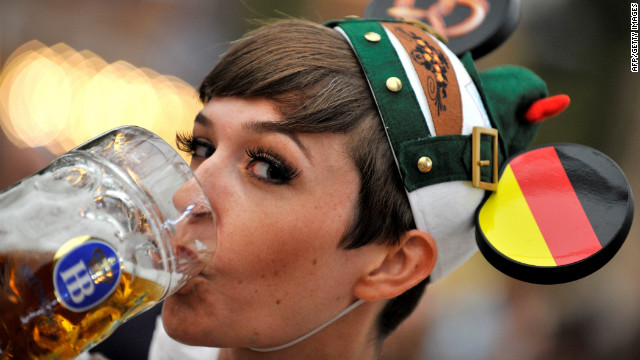 A young woman drinks beer at the Oktoberfest beer festival on Monday, September 24.