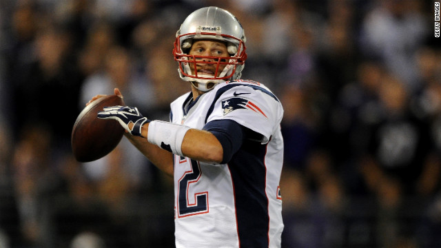 Patriots quarterback Tom Brady throws a pass in the first half against the Ravens.