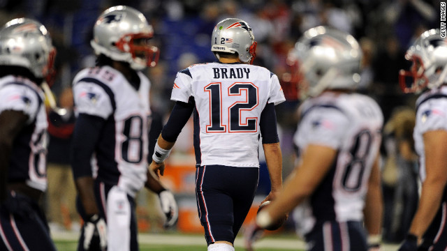Patriots quarterback Tom Brady takes the field for Sunday night's game against the Ravens.