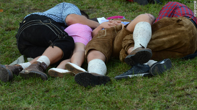 Visitors rest on the grass on Sunday.