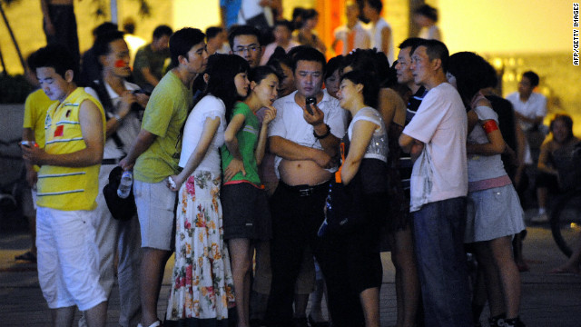 During the 2008 Beijing Olympic Games a group of residents in one of the capital's old neighborhood gathered to watch the opening ceremony on a single shou-ji (hand machine).