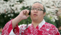 A Sumo wrestler talks on a mobile phone