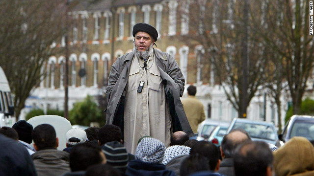 Abu Hamza al-Masri addresses followers during Friday prayer in near Finsbury Park mosque in north London, March 2004.