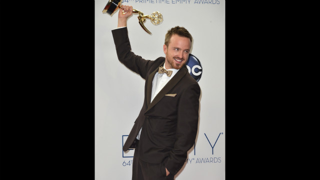 Aaron Paul of &quot;Breaking Bad&quot; shows off his Emmy for best supporting actor in a drama.