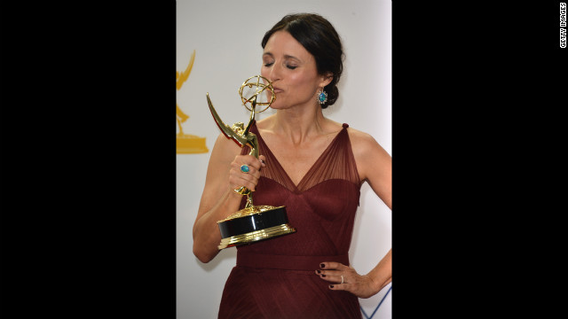 Julia Louis-Dreyfus of &quot;Veep&quot; kisses her trophy for best lead actress in a comedy. 