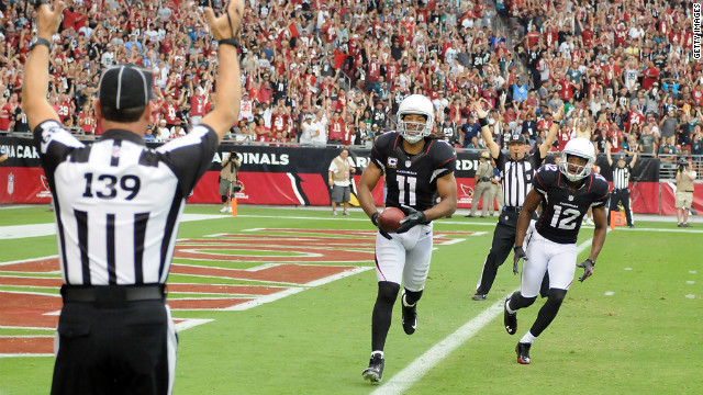 Larry Fitzgerald of the Arizona Cardinals, left, and teammate Andre Roberts celebrate a touchdown against the Philadelphia Eagles on Sunday in Glendale, Arizona.