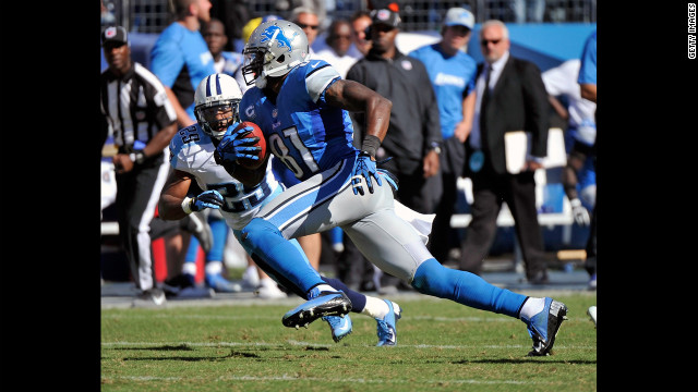 Calvin Johnson of the Detroit Lions runs after catching a pass against the Tennessee Titans.