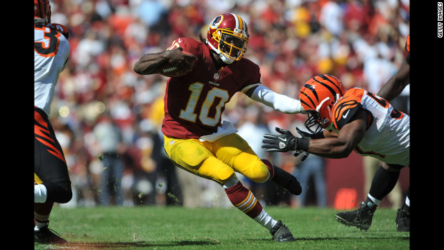 Redskins quarterback Robert Griffin III runs against the Bengals.