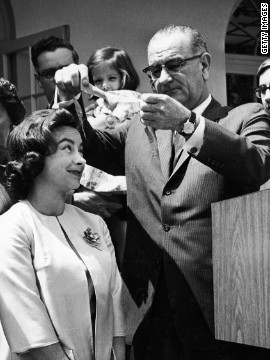 American Jerrie Mock receives an award from President Lyndon B. Johnson in 1964 after becoming the first female to fly solo around the world.