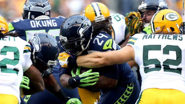 Marshawn Lynch of Seattle runs the ball Monday.