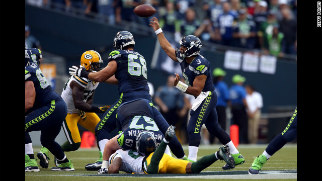 Seattle's Russell Wilson throws the ball in Monday night's game against Green Bay.